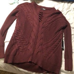 Brand new sweater with decorative neck line